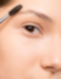 woman-applying-mascara-3762665.jpg