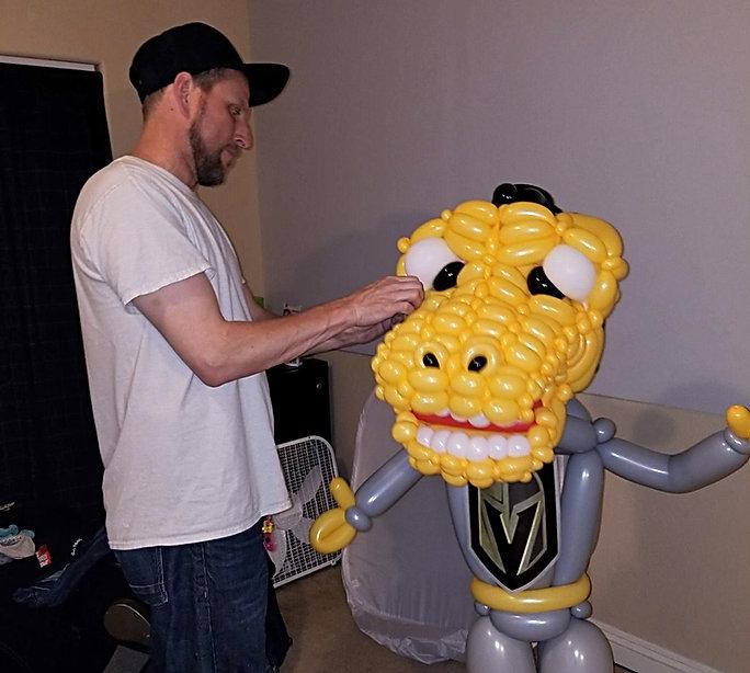 Balloon Artist Jeremy Johnston creating a balloon mas