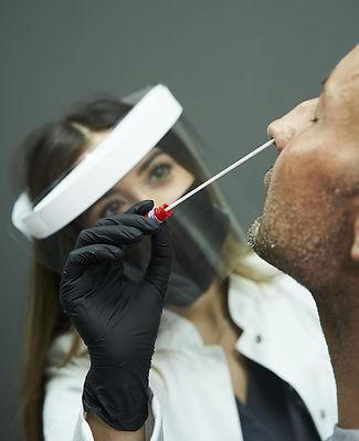 female-doctor-doing-nasopharyngeal-swab-