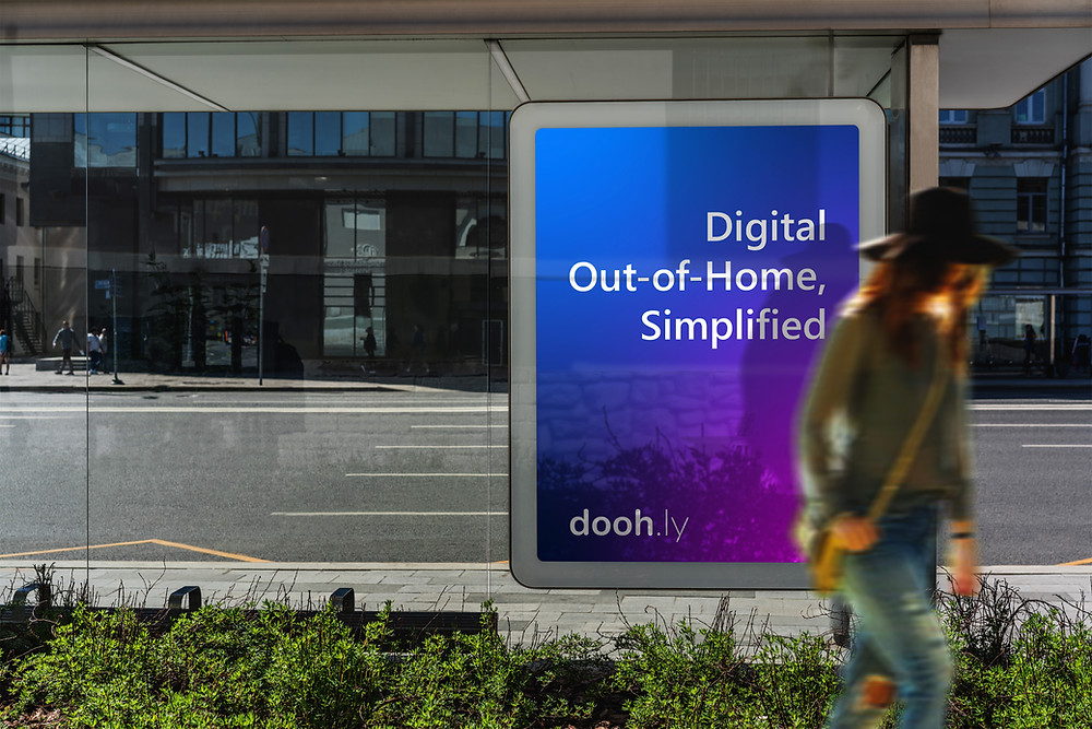 Doohly digital signage with lady walking past