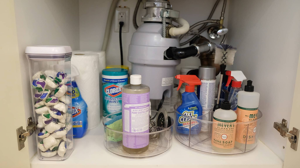 Lazy Susan used to organize under the kitchen sink