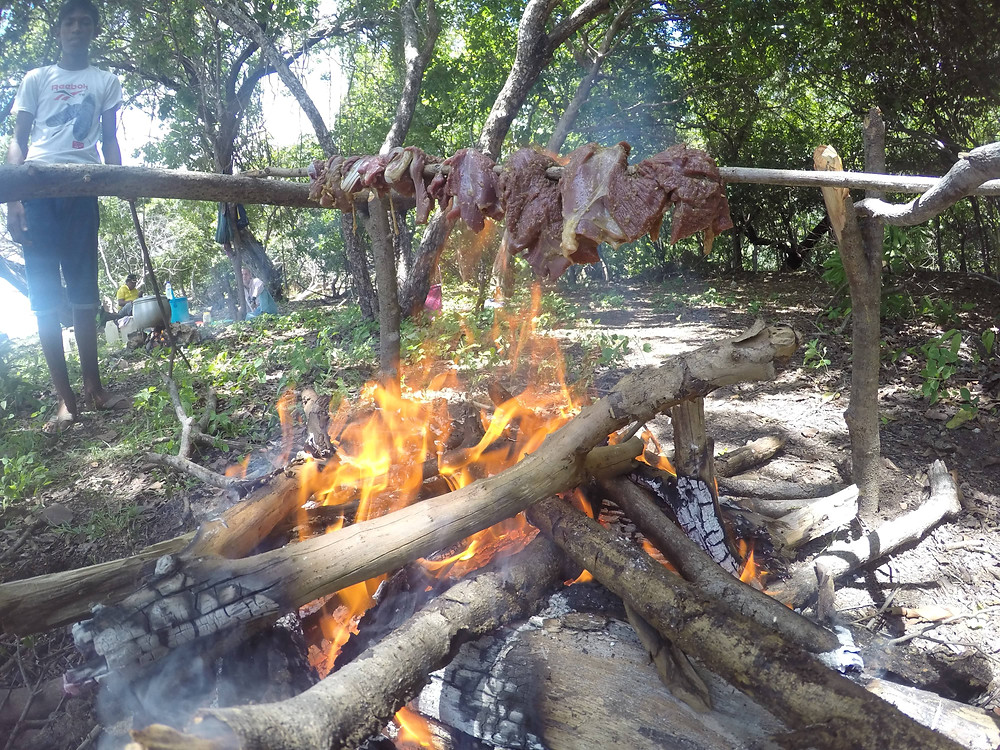 Goat roasting over a fire
