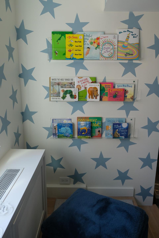 Organized nursery book shelves