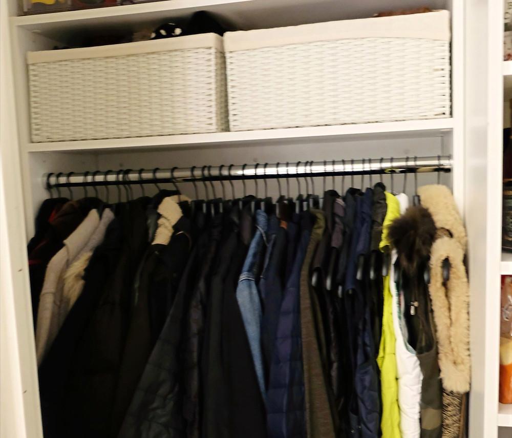 An organized entryway closet