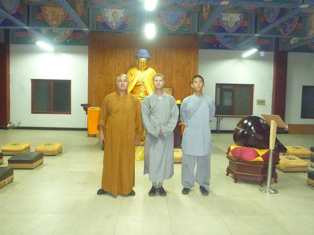Ben posing with other monks at a temple in China
