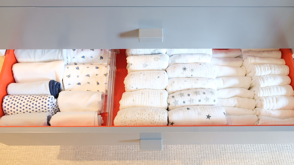 organized drawer of baby items