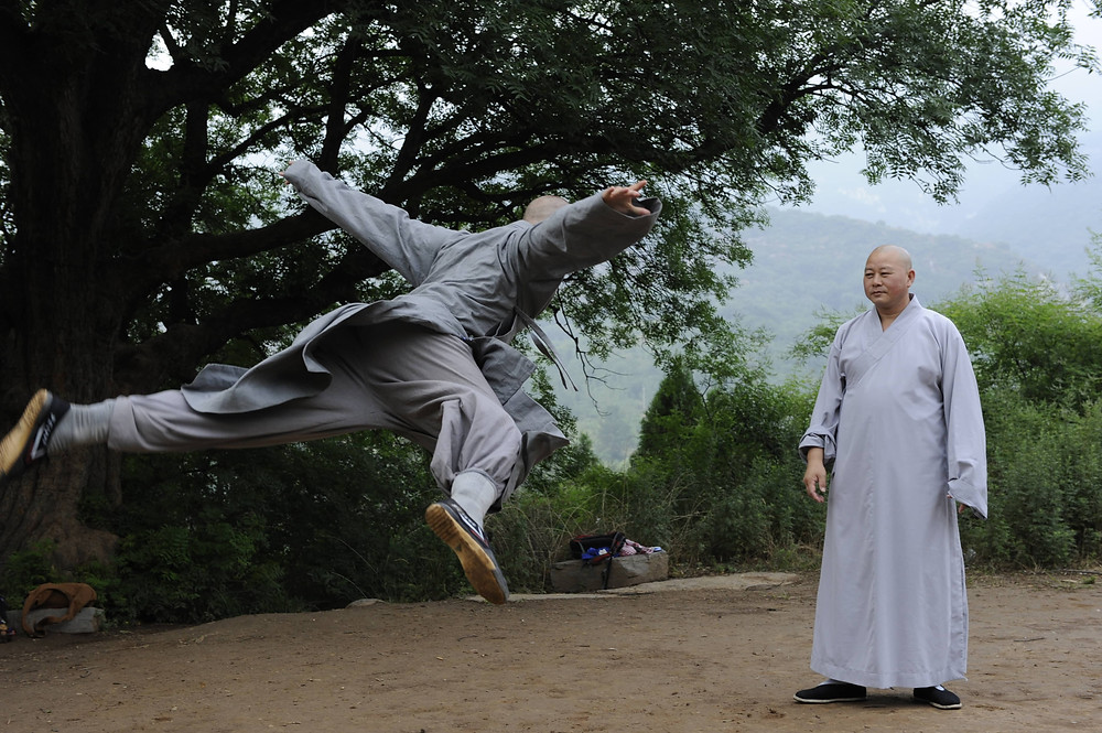 Ben flying through the air during his training as a monk