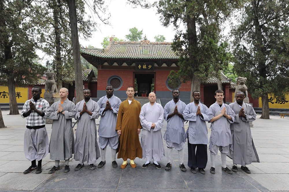 Africans and Ben outside the Shaolin Temple