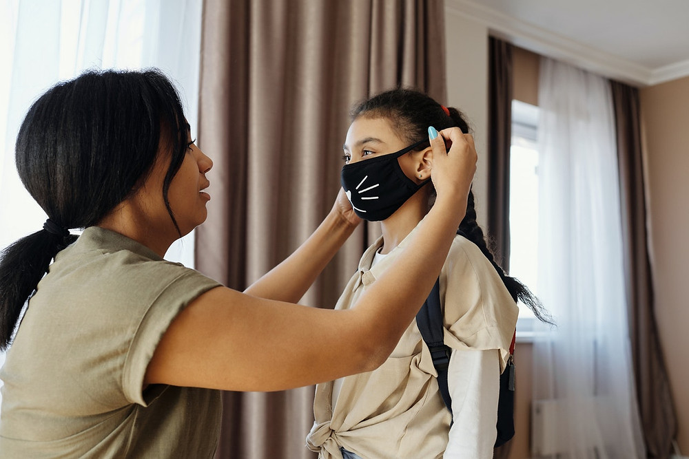 Woman puts on young girl's mask