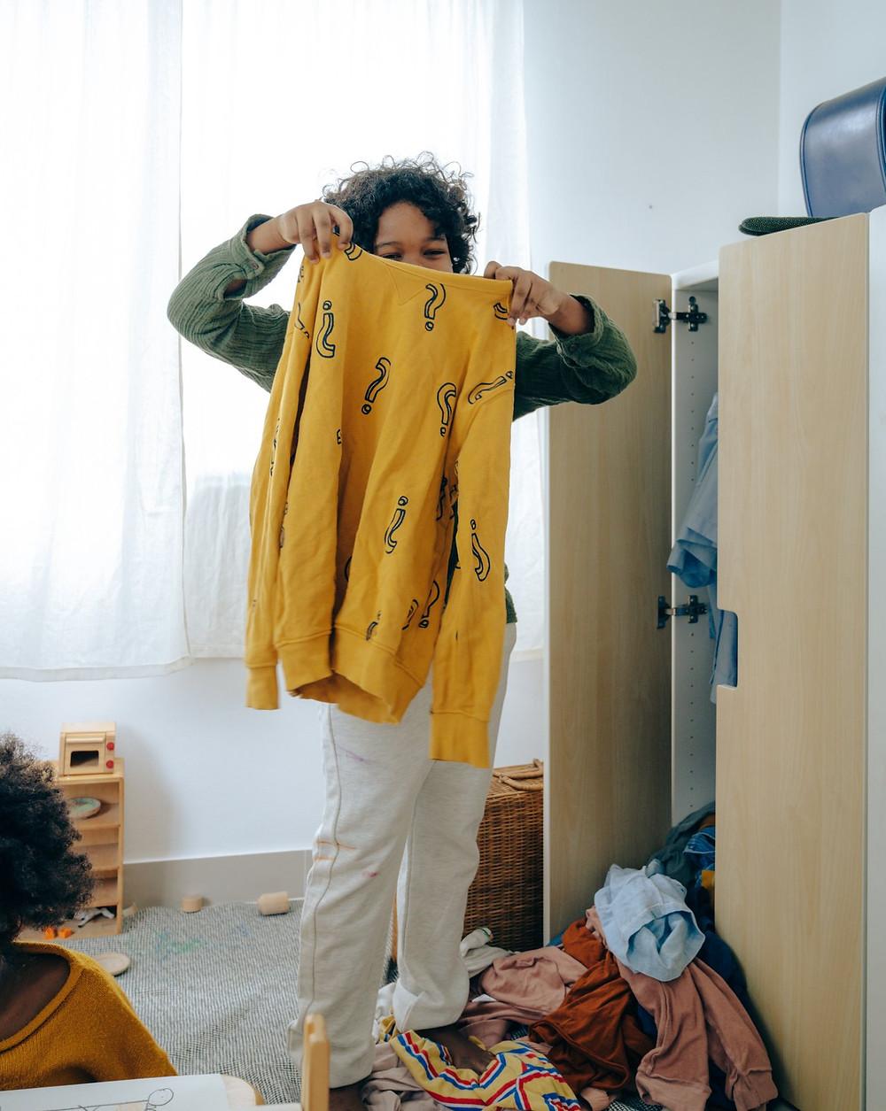 Teen organizing a closet