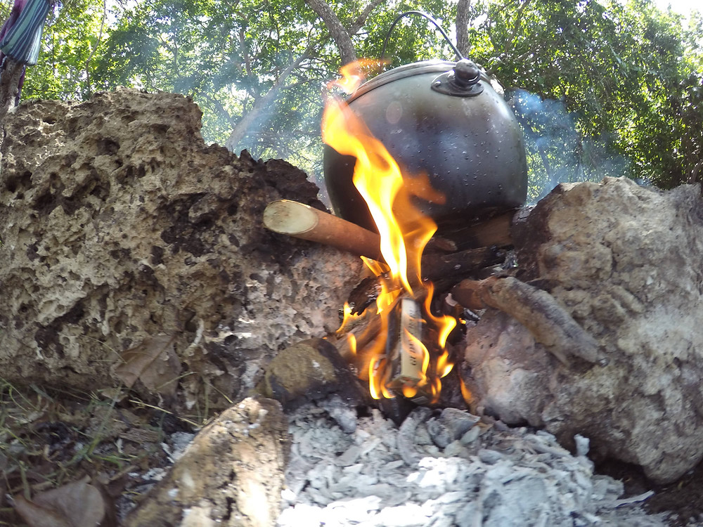 Goat stew cooking over the fire in Indonesia