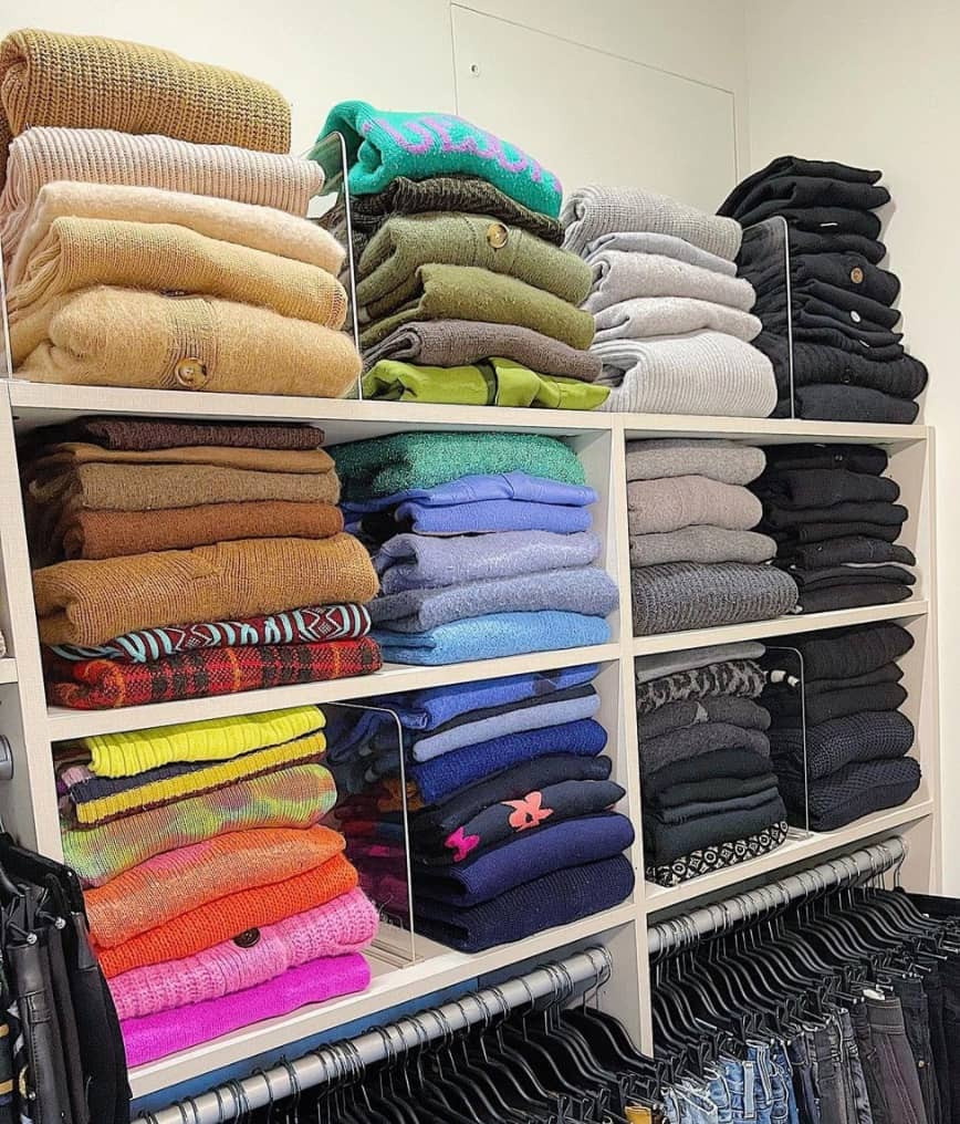 Clothing folded and stacked with acrylic shelf dividers