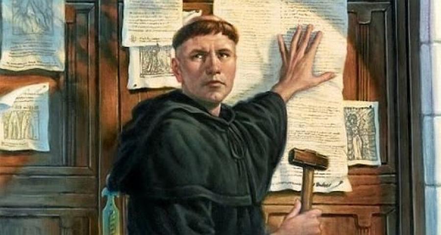 Marcin Luter przybija swoje tezy do drzwi kościoła