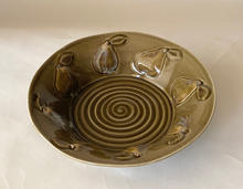 Pearware Bowl thrown and embossed with celadon glaze