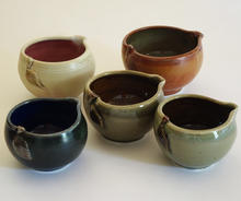 Grouping of small pouring bowls each piece priced individually