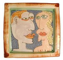 Naked Couple plate, coloured slip, glaze