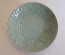 Plate porcelain with slip decoration and celadon glaze