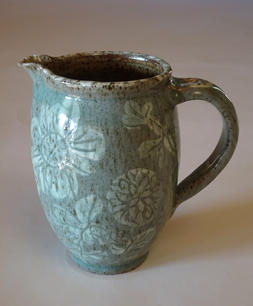 Pitcher slip and sgraffito decoration