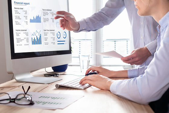 Team of consulting auditors auditing the financial report data of the company (balance she