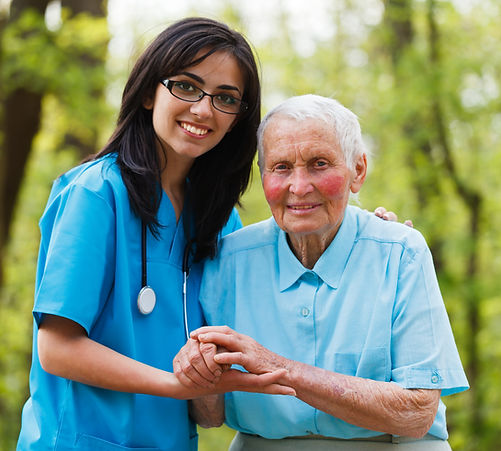 Kind nurse together with elderly woman i