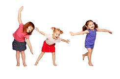 Happy little children dancing in air. Re
