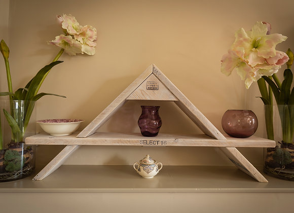 Pyramid display shelving made from reclaimed scaffolding