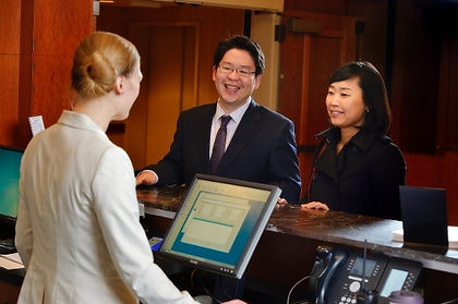 Couple Checking into Hotel - with clerk
