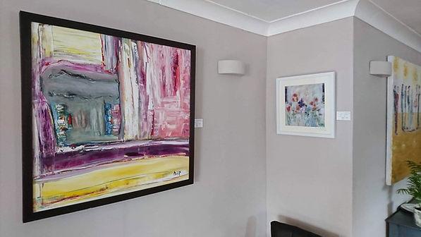 various paintings on display at Penrose