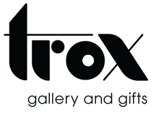 No Coast Film Fest sponsor logo: Trox gallery and gifts in black.