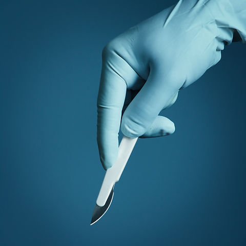 Hand surgeon holding a scalpel.jpg