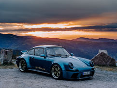 Blue EVOMAX in the mountains by sunset.j
