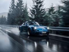 Blue EVOMAX driving in the rain.jpg