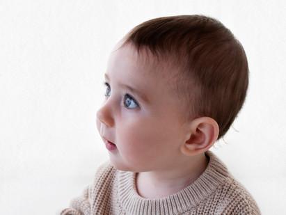 Baby photo shoot in white studio