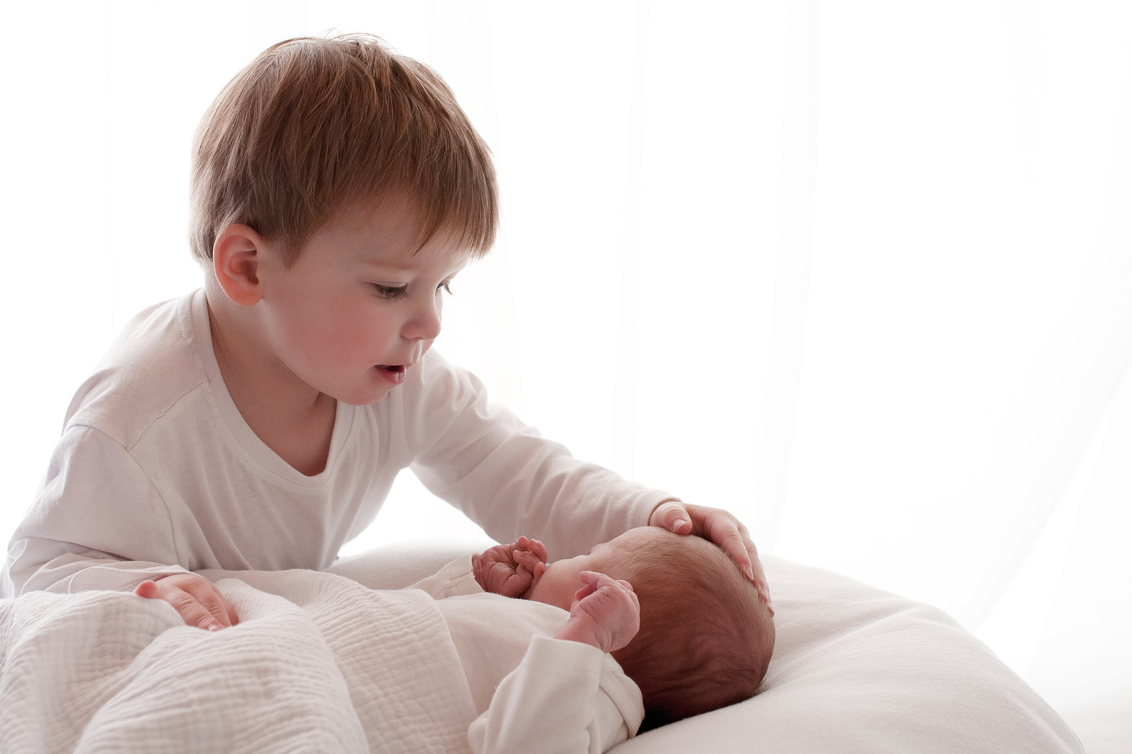 Photographer near me natural newborn baby with brother sister