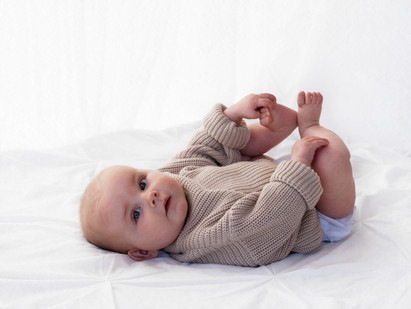 baby on bed lifestyle photography photographer Bracknell