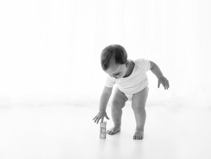 black and white baby photoshoot natural playing
