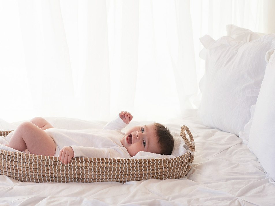 baby on bed lifestyle photography photographer Farnham