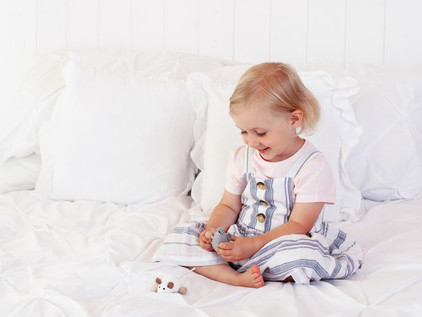 girl playing on bed natural pictures aldershot fleet farnham photography
