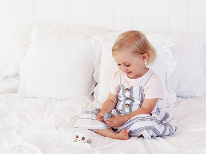 girl playing on bed natural pictures aldershot fleet farnham photography