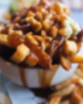 A bowl of poutine in a small French Cana