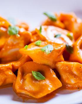 Delicious tortellini pasta in red tomato