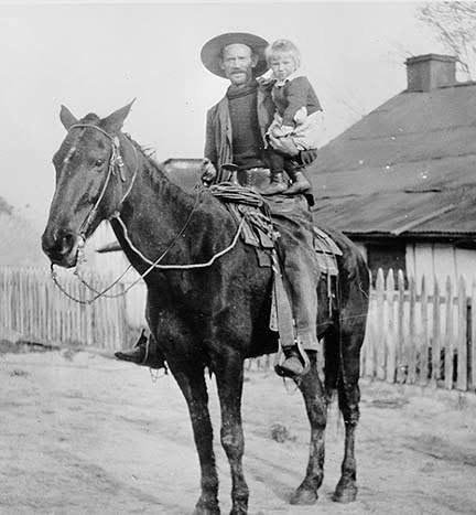 Sam Taylor as cattle forman with son Charlie