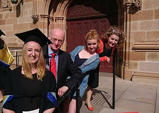 A family celebrating university graduation of their young adult