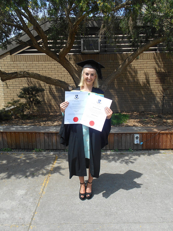 Image of Career success.Young person holding Degrees at Graduation.JPG