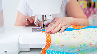 Somebody sewing on sewing machine at Northwich sewing workshop