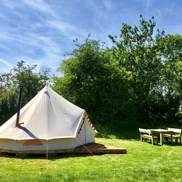 Bell tent table, charis and fire.jpg