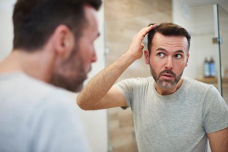 mature-men-is-worried-about-hair-loss-D83NCF2.jpg