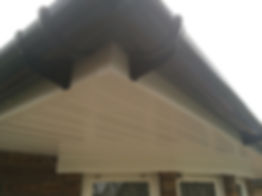 White replacement fascia, soffit, black half round guttering.