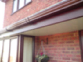 Mahogany fascia, white soffit and brown ogee gutters.