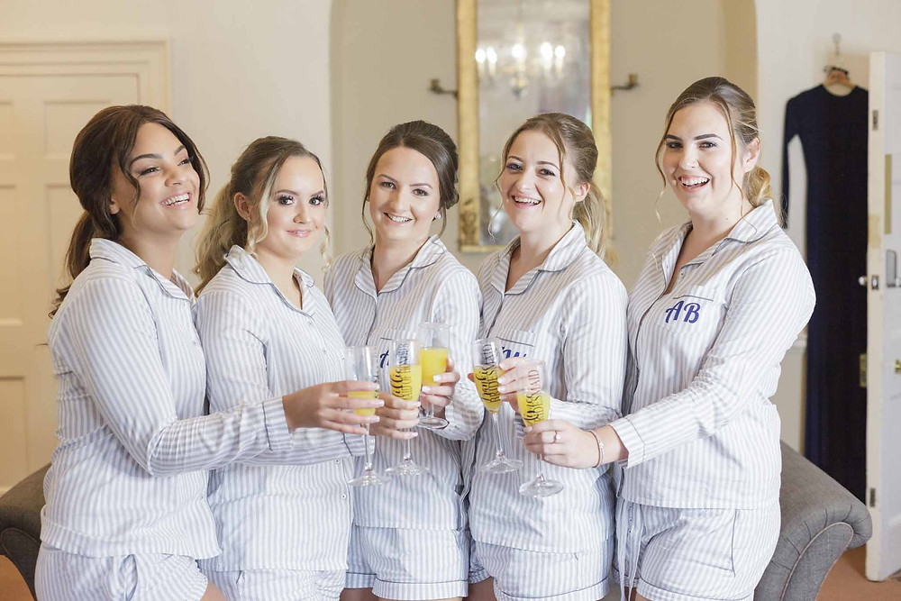 bridesmaids sharing a toast towards the camera
